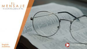 A par of reading glasses sitting on top of an open Bible