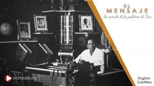 Picture of Brother Felix Y. Manalo while sitting at his desk with numerous picture frames and books behind him