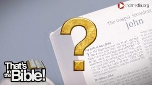 The first page of the book of John in the Bible and a gold question mark