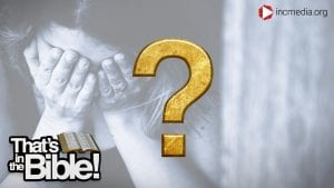 a woman holding her hands to her face and a gold question mark