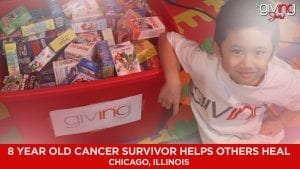 Young boy looking up with a container filled with band aid boxes.