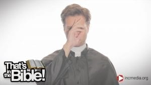 A male priest wearing a white undershirt and a black long sleeve, places his right hand on his forehead.