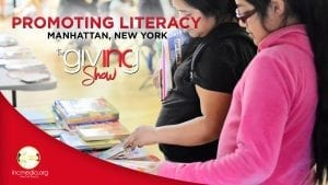 """Two women looking through stack of children's book on a table with text overlay: """"Promoting Literacy, Manhattan, New York, The INC Giving Show"""""""