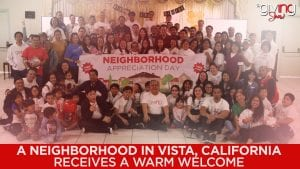 """Church congregation and visitors holding """"Neighborhood Appreciation Day"""" banner"""