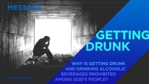 """Silhouette of man sitting under an overpass with his head in his hands with text overlay on blue diagonal ribbon shape with text overlay: """"Getting drunk - why is getting drunk and drinking alcoholic beverages prohibited among God's people?"""""""