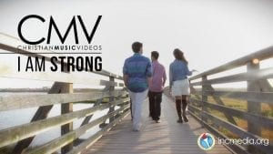 """People walking on wooden bridge with text overlay: """"I am strong"""""""