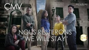 """A group of young people standing in front of buildings with text overlay Nous Resterons """"We Will Stay."""""""