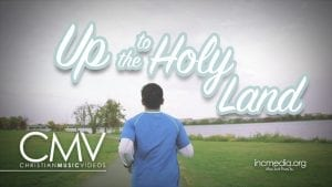 """man wearing blue running with overlay text: """"Up to the Holy Land"""""""
