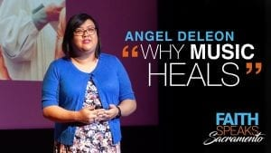 """woman with blue cardigan talking to audience with overlay text: Angel Deleon """"Why Music heals"""" - Faith Speaks Sacramento"""