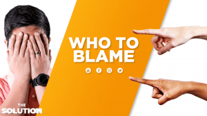 Two different fingers pointing to a person covering his face with text overlay Who to Blame.
