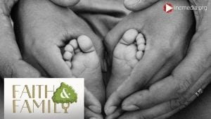 close up of baby feet being held by hands and another set of hands holding the hands