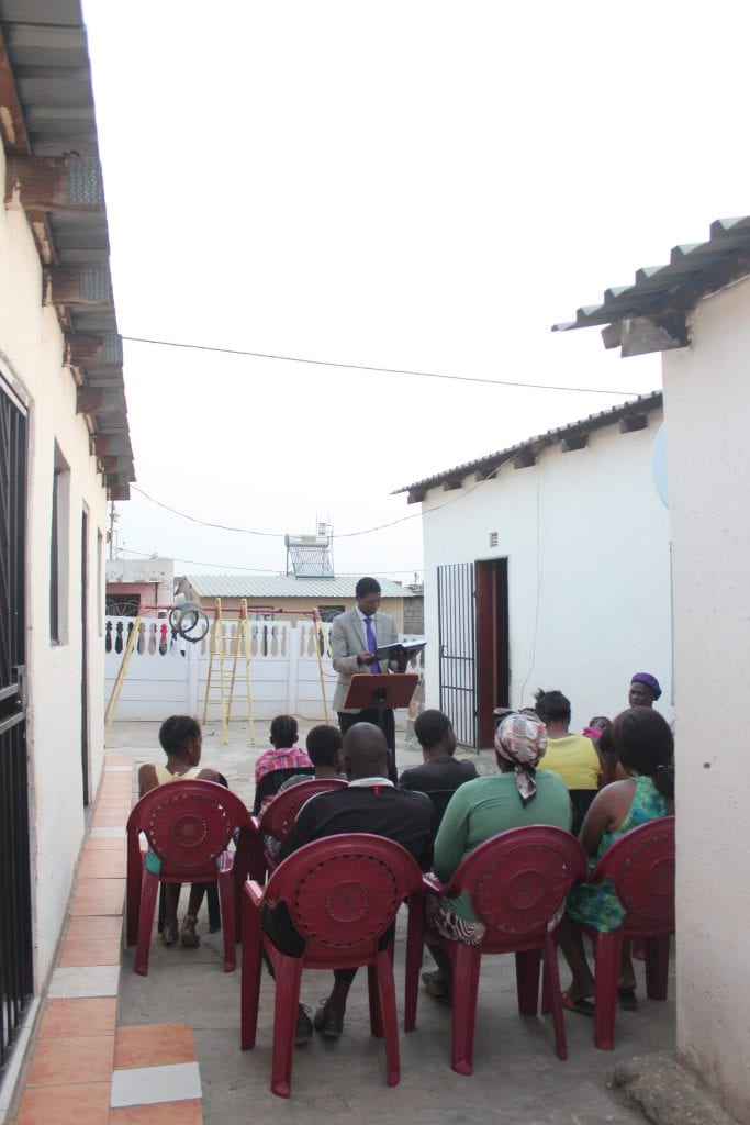 minister preaching to group of south africans outside