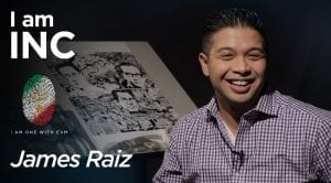 Man smiling in a dark room with a collage drawing behind him with text overlay I am INC, James Raiz.