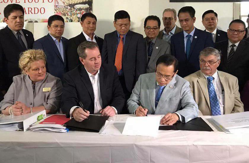 Jun Santos, minister from Church Of Christ, Iglesia Ni Cristo, signing papers of purchase of land in Johnsonville, Connecticut