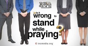 """4 people praying with overlay text: """"Is it wrong to stand while praying?"""""""