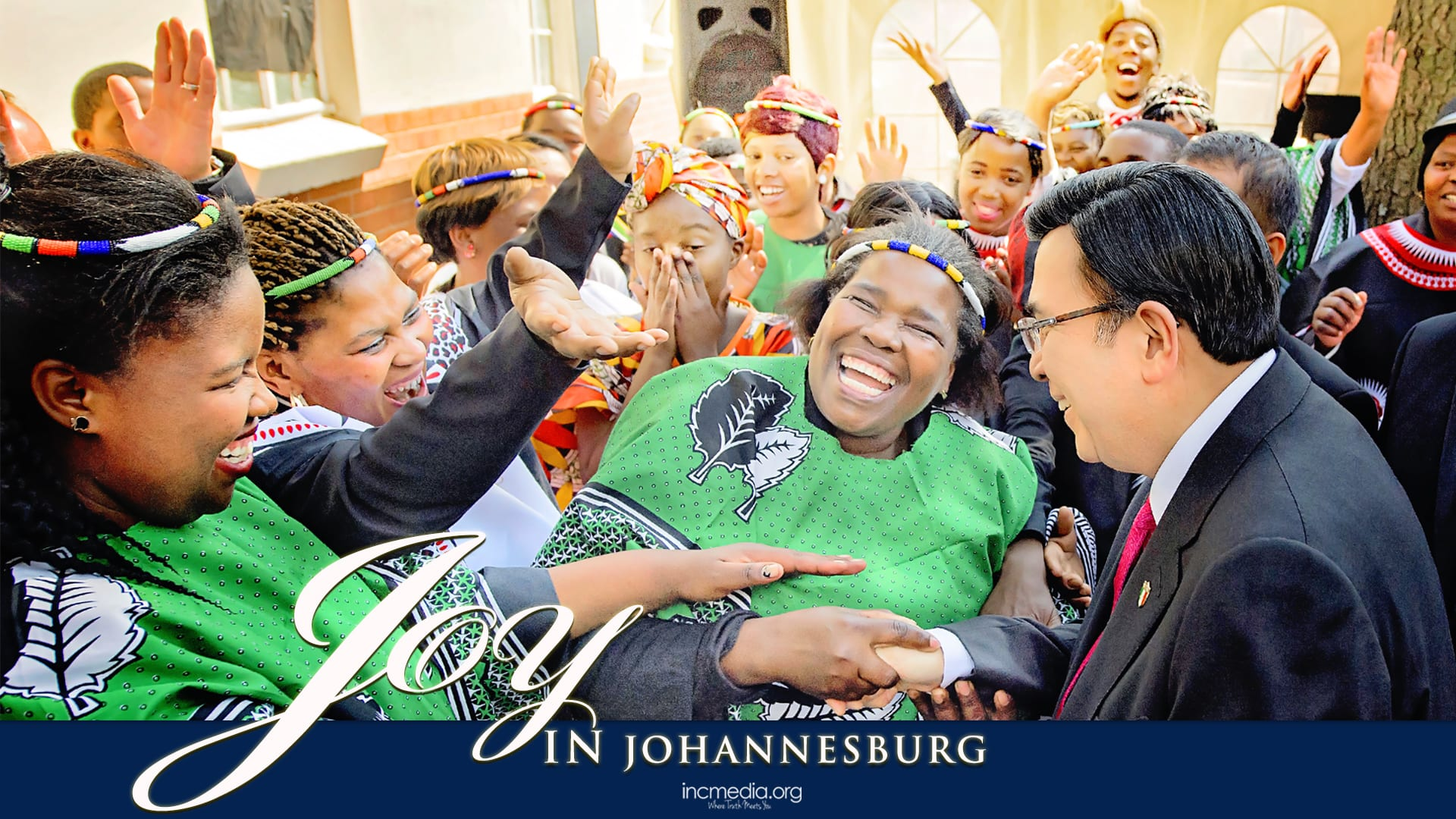 Crowd of Africans, smiling, shaking hands with Brother Eduardo V. Manalo (Executive Minister of the INC) with text overlay: Joy in Johannesburg