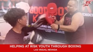 Young boy training with boxing coach