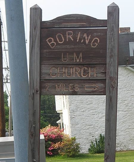 A wooden sign that reads Boring U.M. Church