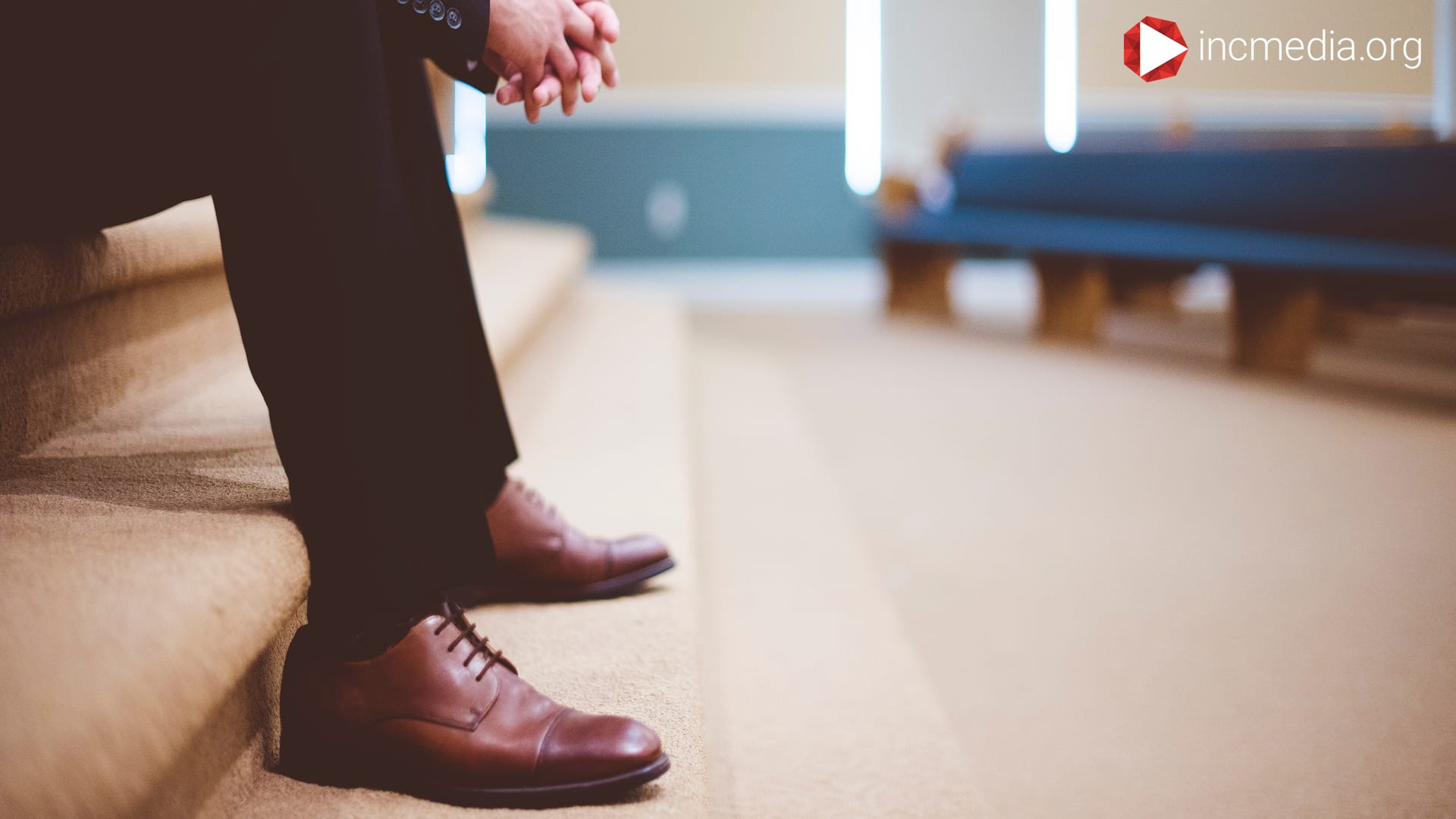 man's brown shoes inside church building