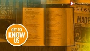 bible opened to the book of Isaiah