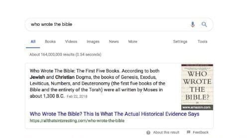 The top half of a search engine results page with the phrase 'who wrote the bible' typed into the search bar.