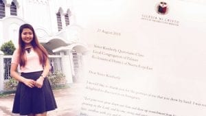 Young girl in front of worship building alongside a letter from the office of the Executive Minister dated August 27, 2015.