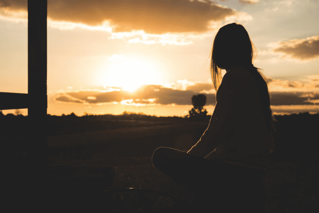 Woman looking at sunset