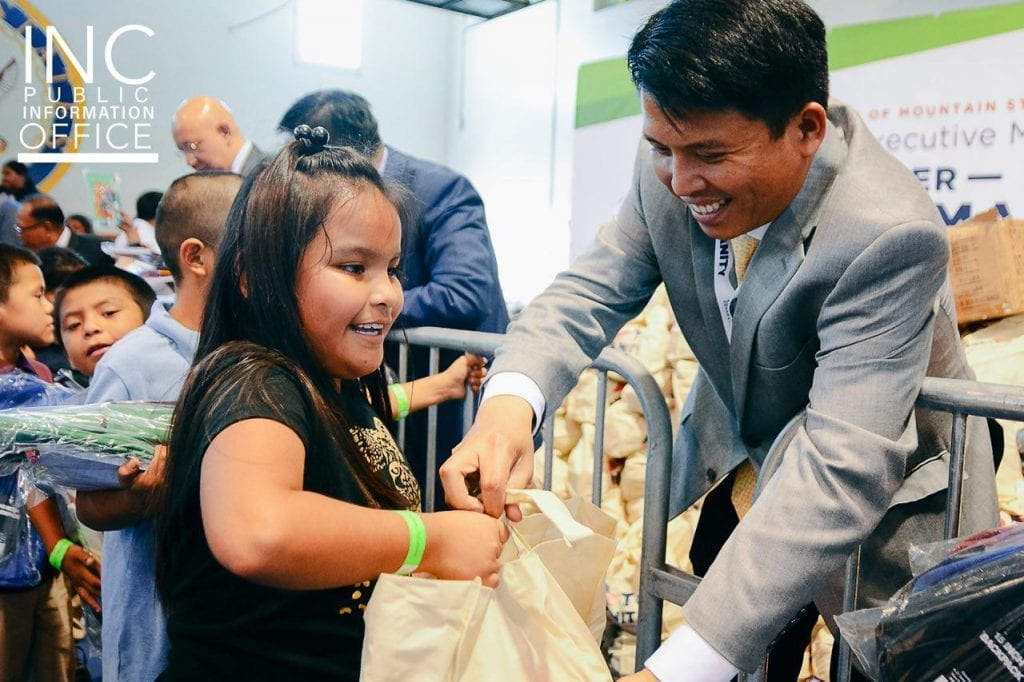 Children received free backpacks with school supplies, together with their care packages of food and basic necessities.