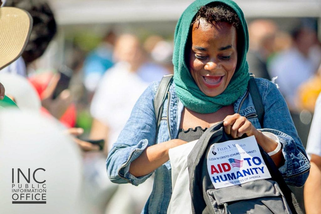 An Oakland resident  is excited to see the care package contents at the Oakland Aid to Humanity event.