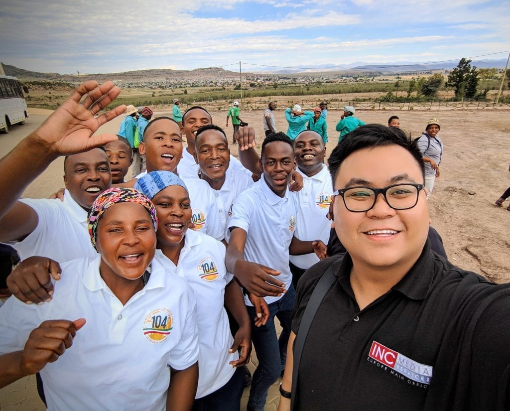 man taking selfie with smiling people from South Africa