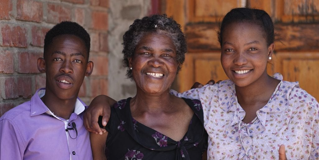 three people smiling together