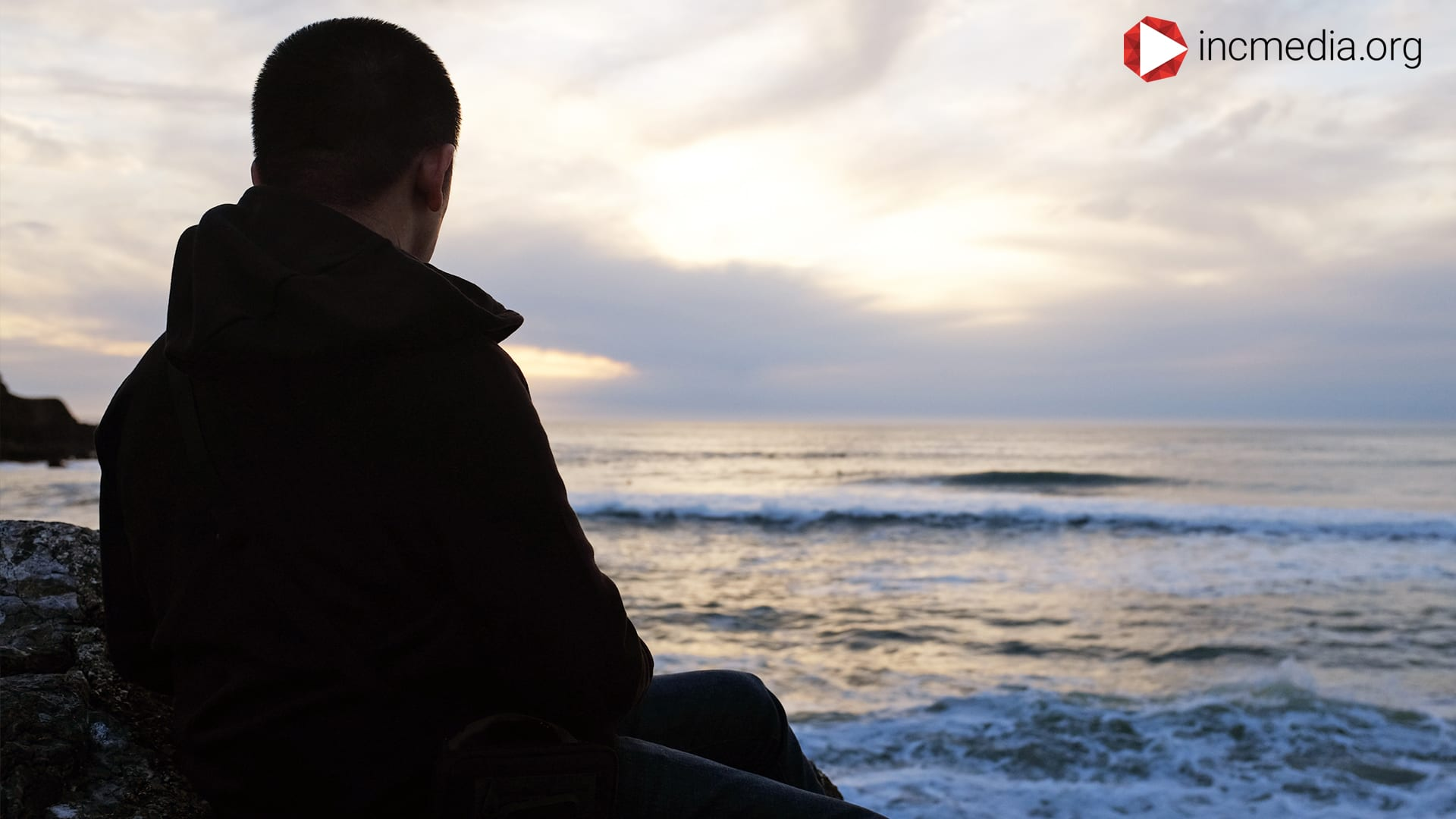 Man pondering looking out into the ocean.
