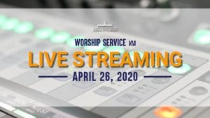worship service via live streaming april 29, 2020 text in front of audio mixer