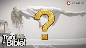 a person floating up in the air with a gold question mark