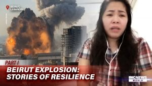 On the left, a freeze frame of an explosion, on the left, a woman in distressed with ear buds.