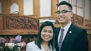 Paolo with his wife in worship service uniforms inside chapel