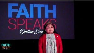 """child speaking to audience with text behind her: """"Faith Speaks Online Event"""""""
