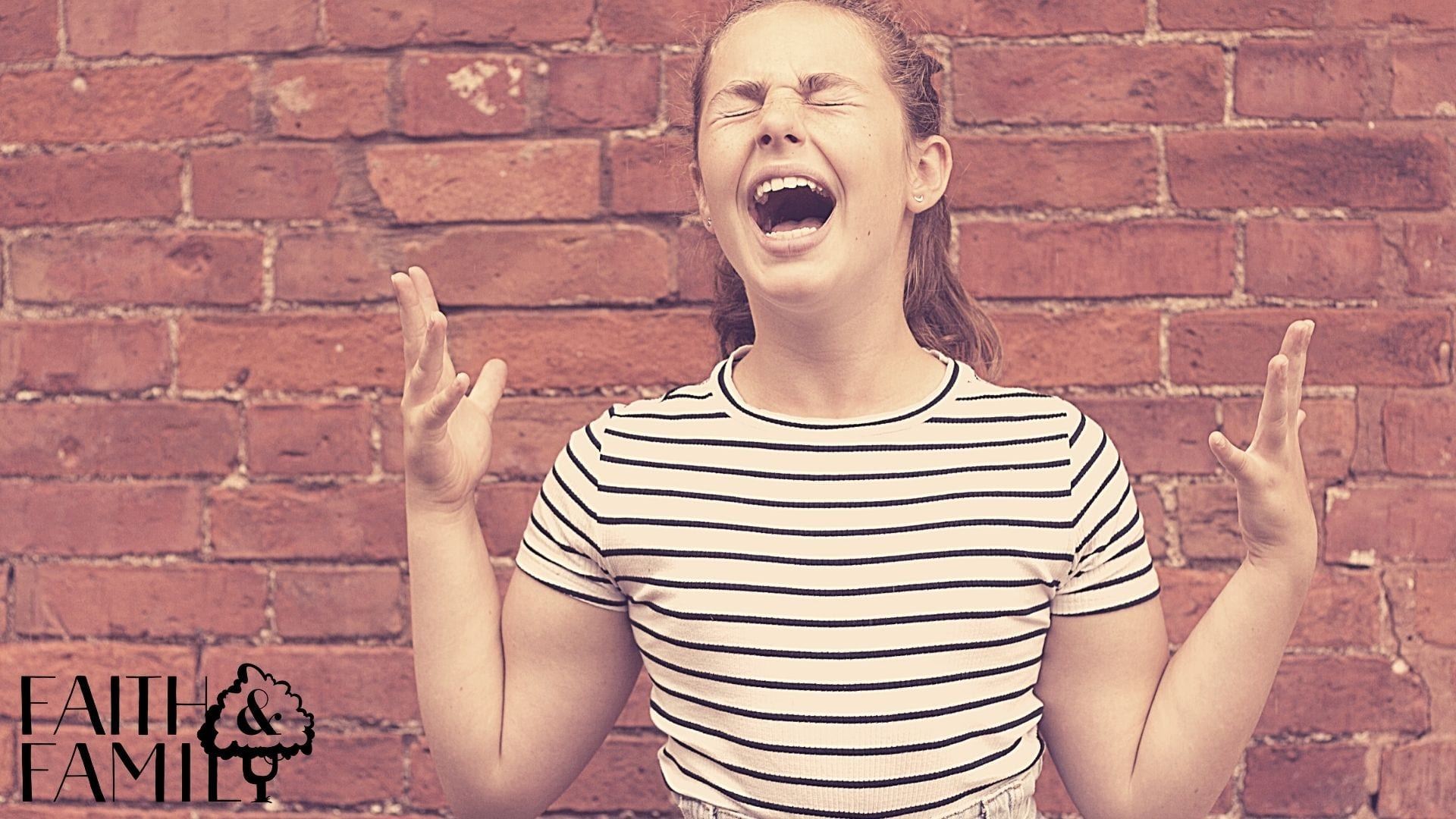 teenager with striped shirt screaming with her hands up