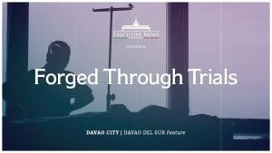 """silhouette of man sitting at table with overlay text: """"Executive News Presents Forged through Trials - Davao City 