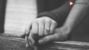 1. couple holding hands with engagement ring