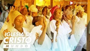 Haitian men and women in white robes