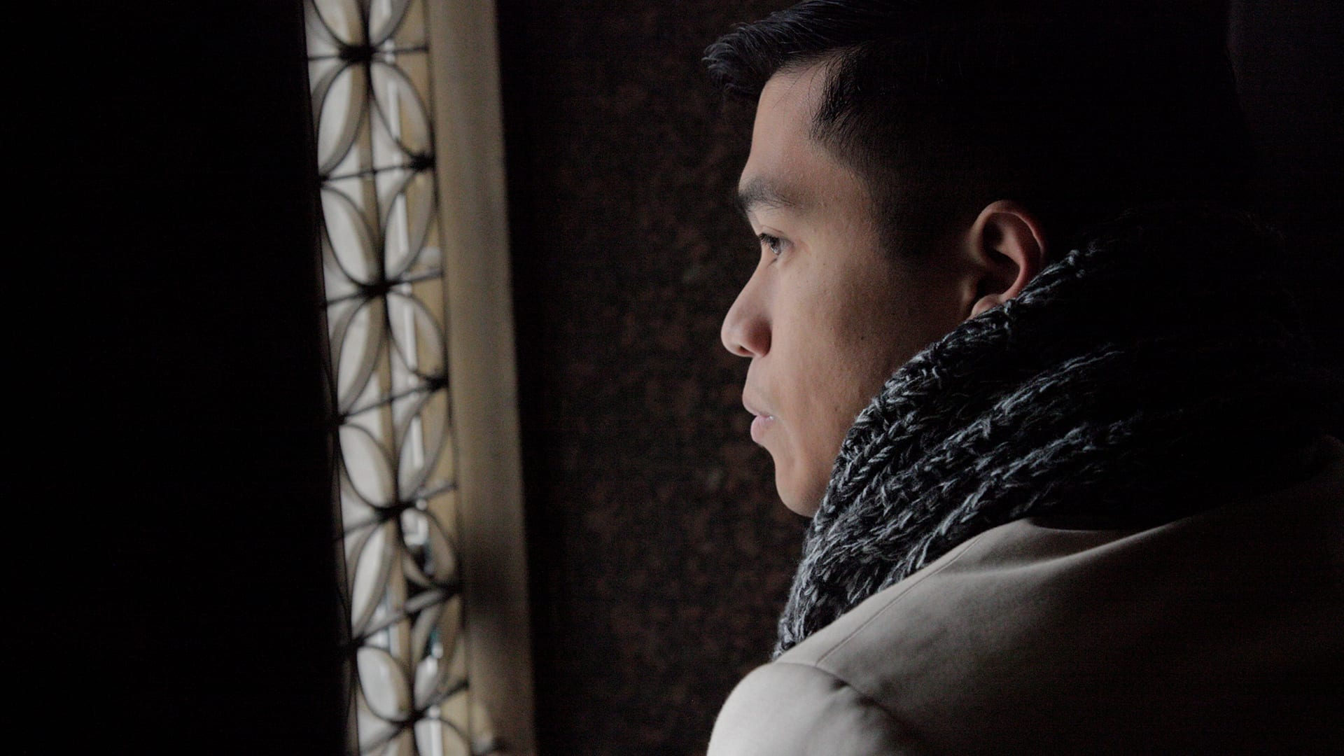 Young man looking out a window