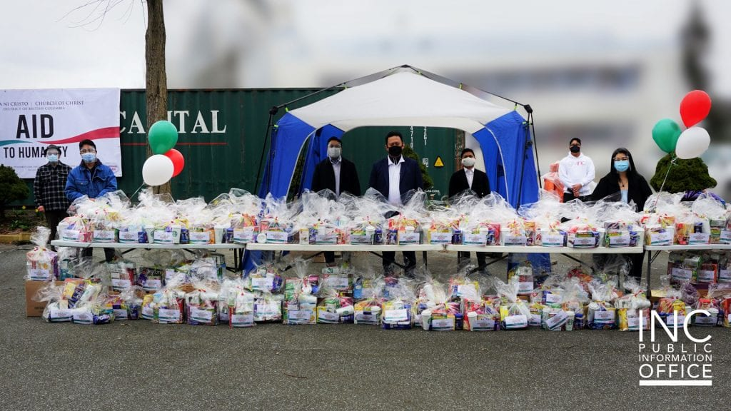 Iglesia Ni Cristo (INC) or Church Of Christ ministers and volunteers in Surrey, Canada pose with part of the 480 care packages, which were prepared to appreciate and uplift frontline workers during the COVID-19 pandemic.