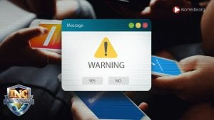 pop up image that says warning on top of a photo with two cell phones being used