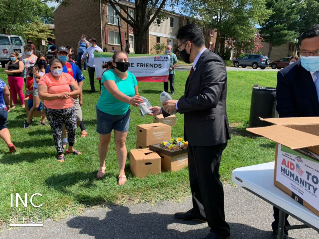 Minister from Iglesia Ni Cristo (INC) or Church Of Christ handing out donations during a community outreach event, held in August 2020.