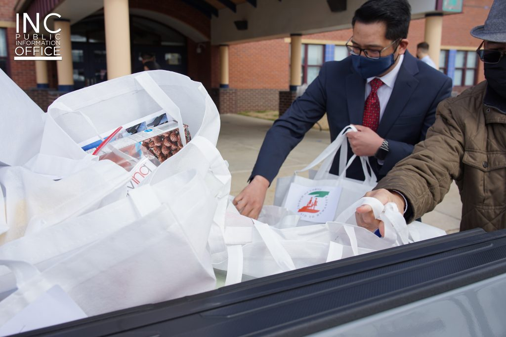 Minister from Iglesia Ni Cristo (INC) or Church Of Christ handing care packages to Essex Elementary School, held in March 2021.