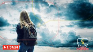 Girl with back pack looking at the clouds