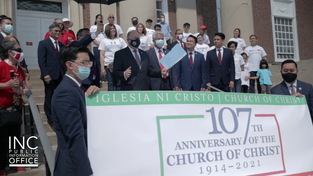 Elizabeth City, NJ Mayor J. Christian Bollwage reads his proclamation with INC Ministers and brethren in attendance