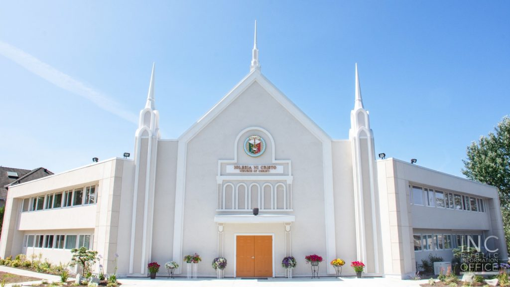 The freshly renovated Iglesia Ni Cristo worship building in Surrey, BC with its newly added steeples, brightly lit by the afternoon sun.