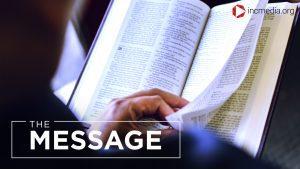 a person flipping through a Bible